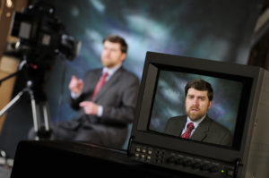 Promotion video filming with a man's face in monitor